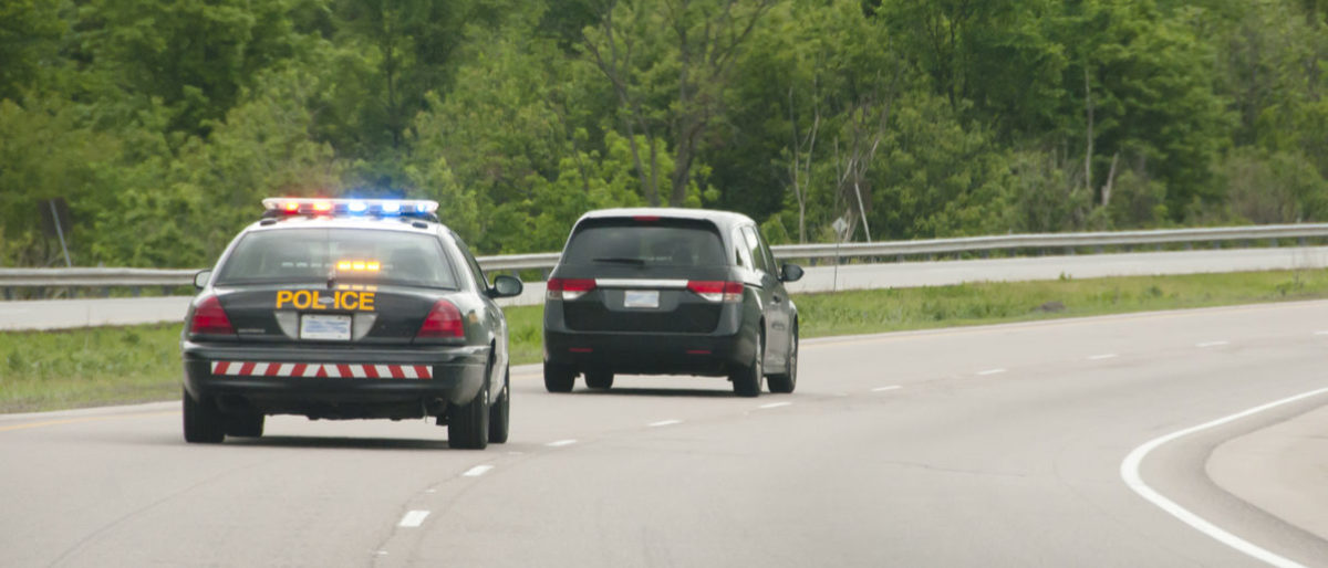 """An Iowa man gets in car chase with police becase it was on his """"bucket list."""" (Shutterstock)"""