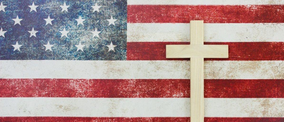 Christian Cross And An American Flag (shutterstock/laura.h)