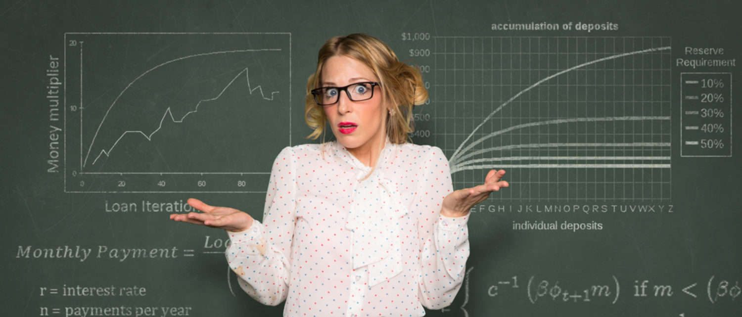 Confused teacher at blackboard (Shutterstock/El Nariz)