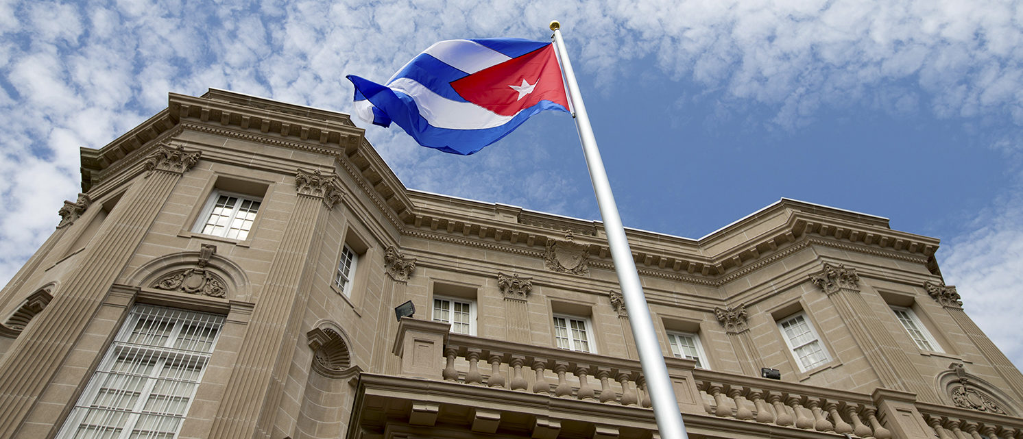 The Cuban national flag is seen raised over their new embassy in Washington, July 20, 2015. The Cuban flag was raised over Havana's embassy in Washington on Monday for the first time in 54 years as the United States and Cuba formally restored relations, opening a new chapter of engagement between the former Cold War foes. REUTERS/Andrew Harnik/Pool