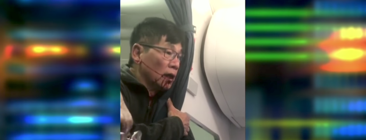 The Department of Aviation in Chicago reportedly fired two officers who participated in the public dragging of David Dao, the 69-year-old doctor who was forcefully booted off a United Airlines flight in April. [Screenshot/YouTube/Public - User: CNN]