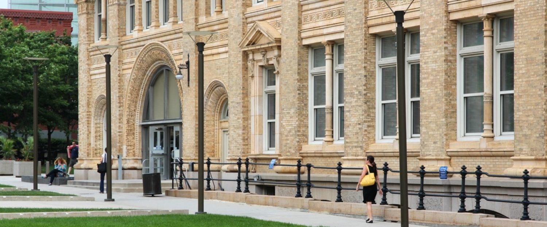 PHILADELPHIA - JUNE 11: Students walk past Drexel University building on June 11, 2013 in Philadelphia. The university exists since 1891 and had 25,500 students in 2012 (Shutterstock/Tupungato)