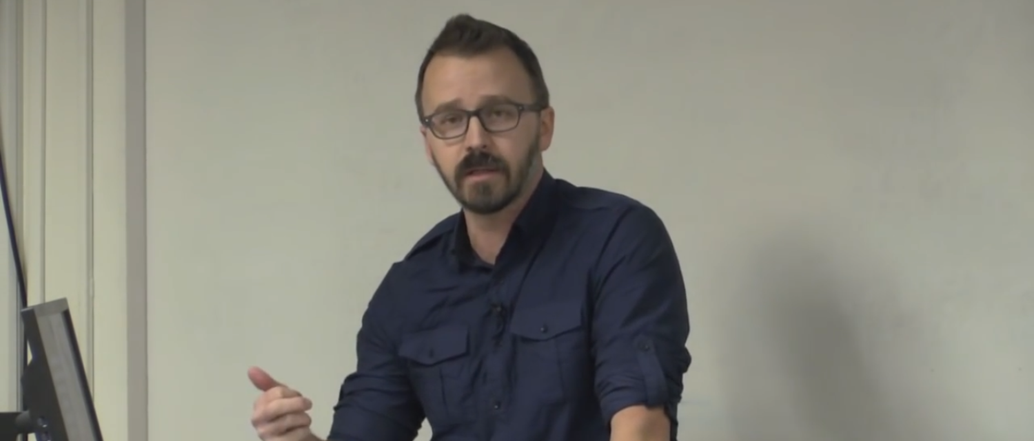 "George Ciccariello-Maher gives a lecture on ""decolonizing dialectics."" (Photo Credit: YouTube/RowanCHSS)"