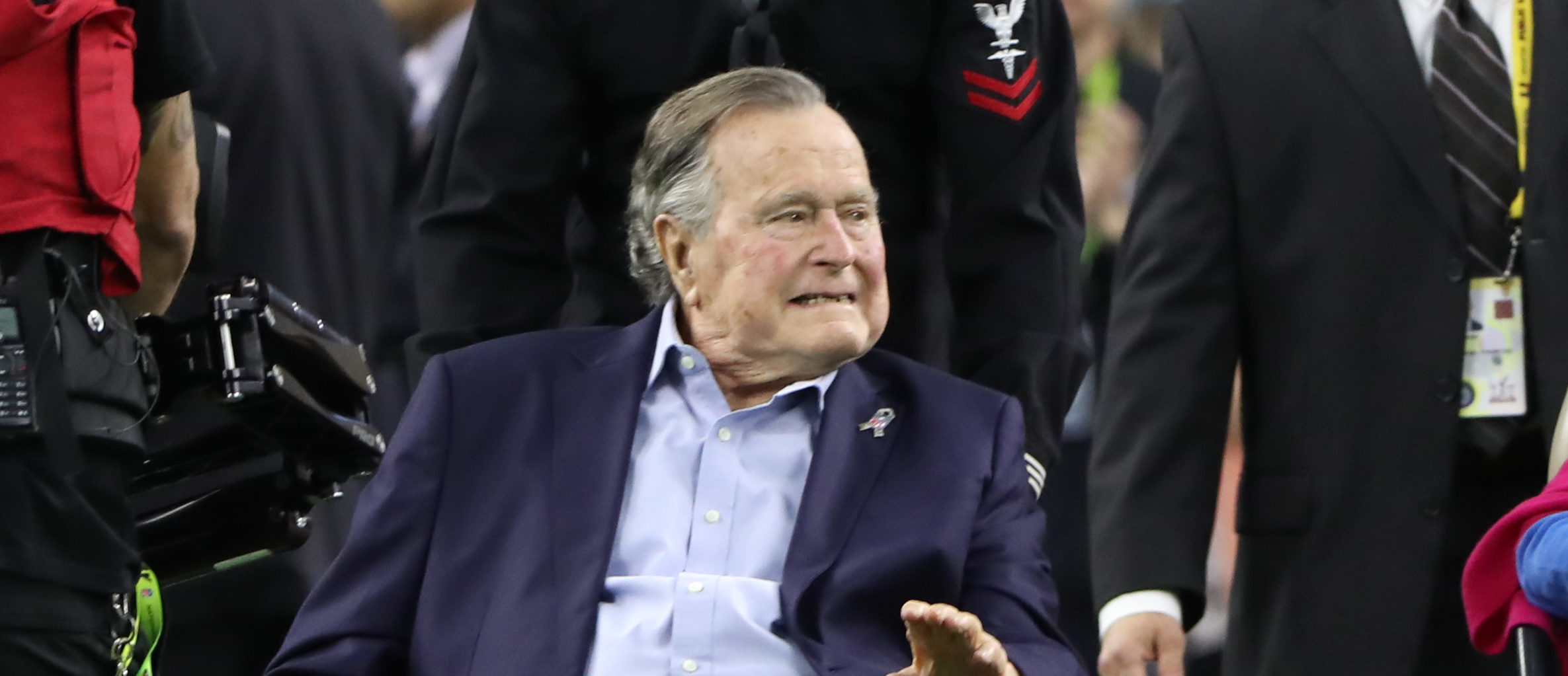 Former President George H.W. Bush and former first lady Barbara Bush arrive on the field to do the coin toss ahead of the start of Super Bowl LI between the New England Patriots and the Atlanta Falcons in Houston, on February 5, 2017. REUTERS/Adrees Latif