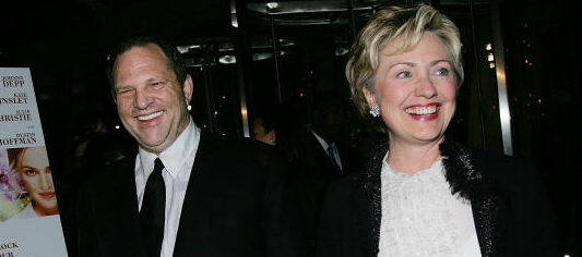 "Harvey Weinstein and Hillary Clinton attending the ""Finding Neverland"" premiere in October 2004 in New York City. (Photo by Evan Agostini/Getty Images)"