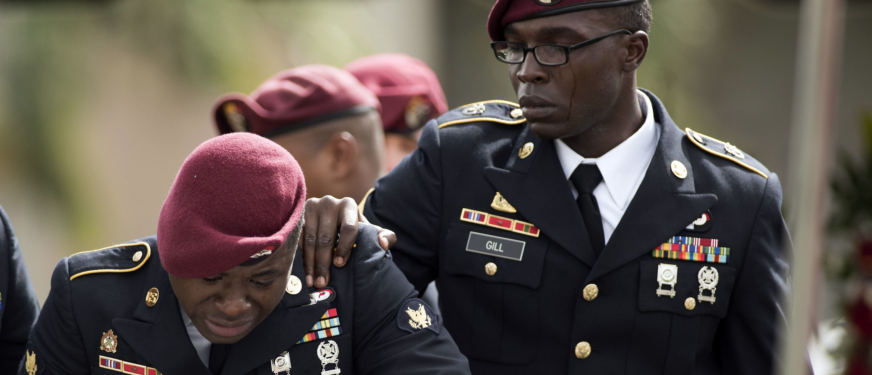 Members of the 3rd Special Forces Group, 2nd battalion cry at the tomb of US Army Sgt. La David Johnson at his burial service in the Memorial Gardens East cemetery on October 21, 2017 in Hollywood, Florida. Sgt. Johnson and three other US soldiers were killed in an ambush in Niger on October 4. GASTON DE CARDENAS/AFP/Getty Images