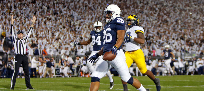 Saquon Barkley of the Penn State Nittany Lions rushes for a 69 yard touchdown in the first half against the Michigan Wolverines in October 2017 at Beaver Stadium in State College, Pennsylvania. (Photo by Justin K. Aller/Getty Images)