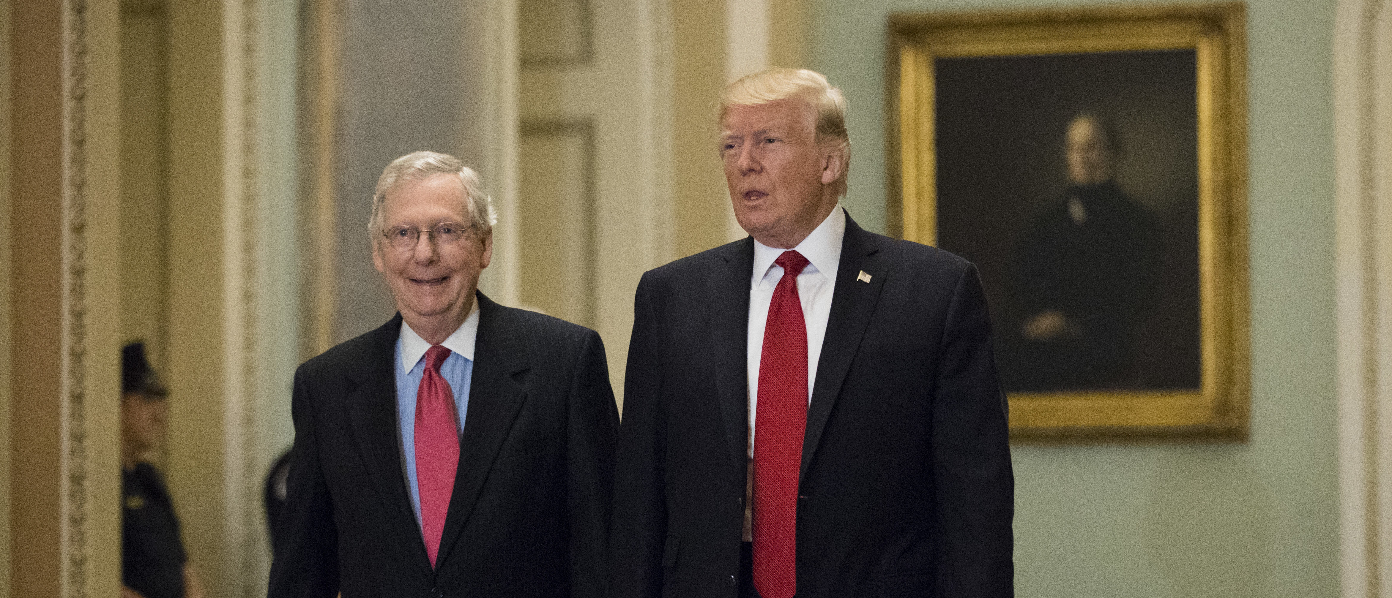WASHINGTON, DC - OCTOBER 24: U.S. President Donald Trump (R) and Senate Majority Leader Mitch McConnell (R-KY) walk to a lunch with Senate Republicans on Capitol Hill, October 24, 2017 in Washington, DC. Trump joined the senators to talk about upcoming legislation, including the proposed GOP tax cuts and reform. (Photo by Drew Angerer/Getty Images)