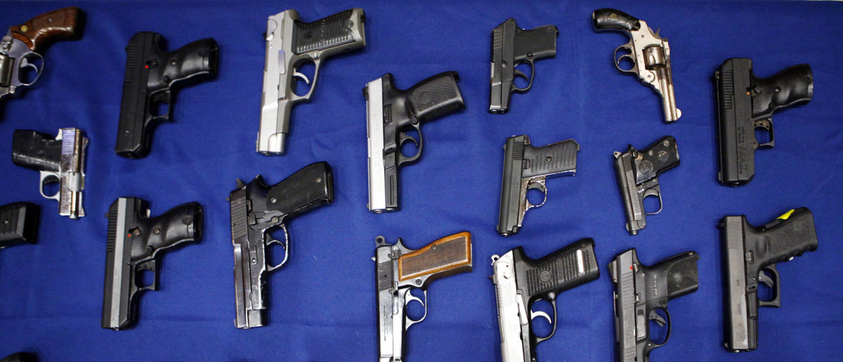 Seized handguns are pictured at the police headquarters in New York, New York August 19, 2013. REUTERS/Eric Thayer