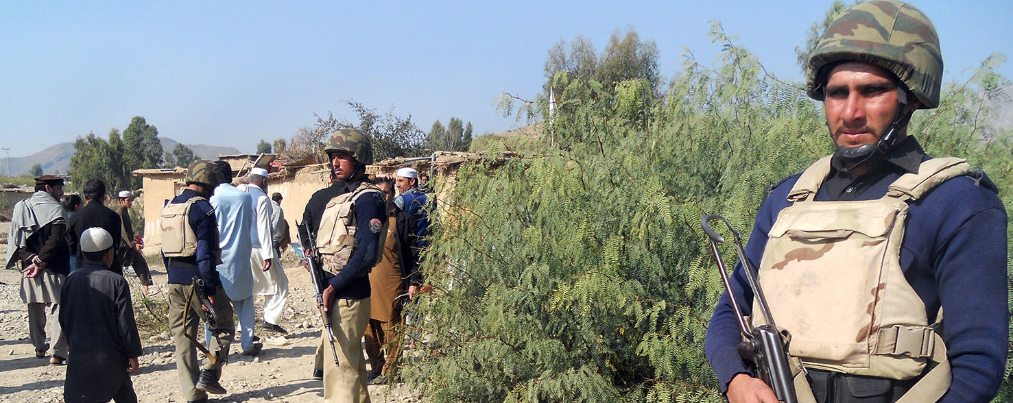 Pakistani policemen stand guard near a destroyed Islamic seminary belonging to the Haqqani network after a US drone strike in the Hangu district of Khyber Pakhtunkhwa province on November 21, 2013. A US drone killed six people in northwest Pakistan in only the second such strike outside the country's lawless tribal districts, threatening to inflame tensions between Washington and Islamabad. Getty Images/AFP PHOTO/SB SHAH