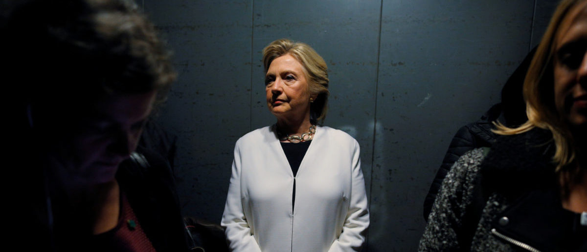U.S. Democratic presidential nominee Hillary Clinton rides an elevator with aides as she arrives for a campaign concert with Katy Perry in Philadelphia, Pennsylvania, U.S. November 5, 2016. REUTERS/Brian Snyder