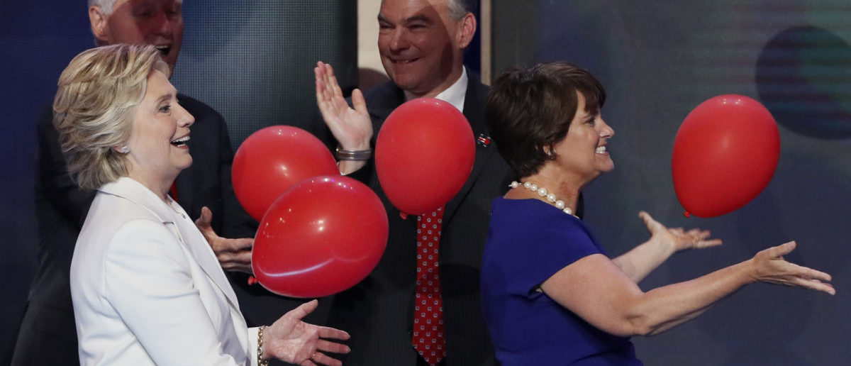 U.S. President Bill Clinton (L) and Hilllary Clinton's vice presidential running mate Tim Kaine look on as Democratic U.S. presidential nominee Hillary Clinton and Anne Holton, wife of Tim Kaine (R), bat ballons after Hillary Clinton accepted the nomination on the final night of the Democratic National Convention in Philadelphia, Pennsylvania, U.S. July 28, 2016. REUTERS/Mike Segar