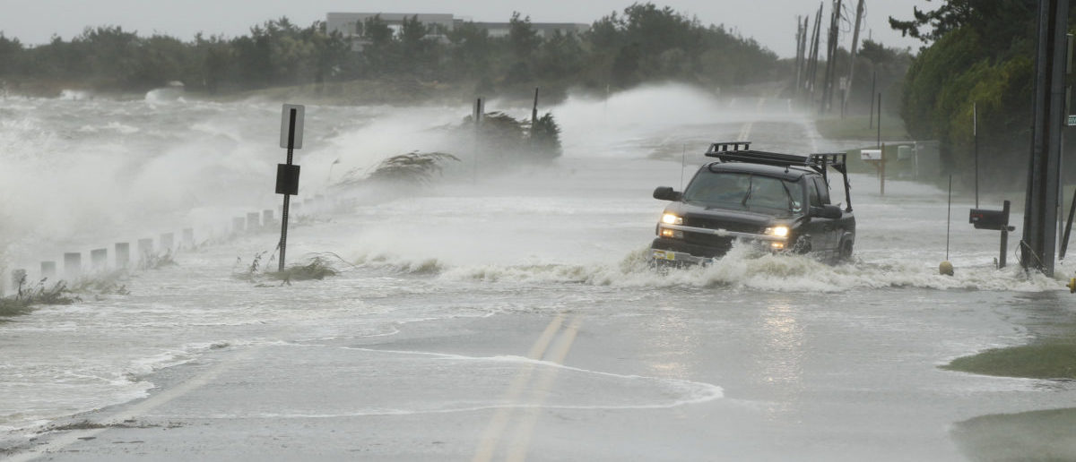 In this picture taken October 29, 2012 a truck drives through storm surge flooding of a road during Superstorm Sandy in Southampton, New York. The historic superstorm killed at least 159 people and damaged more than 650,000 homes when it made landfall on October 29, 2012, devastating parts of New York, New Jersey and several other states. Picture 2A. (Photo: REUTERS/Lucas Jackson)