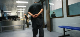 An immigrant walks in chains through a U.S. Immigration and Customs Enforcement (ICE), processing center after being detained on October 14, 2015 in Camarillo, California. ICE says they build deportation cases against thousands of undocumented immigrants and Green Card holders convicted of crimes. The number of ICE detentions and deportations from California has dropped since the state passed the Trust Act in October 2013, which set limits on California state law enforcement cooperation with federal immigration authorities. (Photo by John Moore/Getty Images)