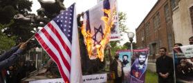Iranian students burn a U.S. flag and an Israeli flag inside the former U.S. embassy in Tehran April 25, 2011. REUTERS/Raheb Homavandi