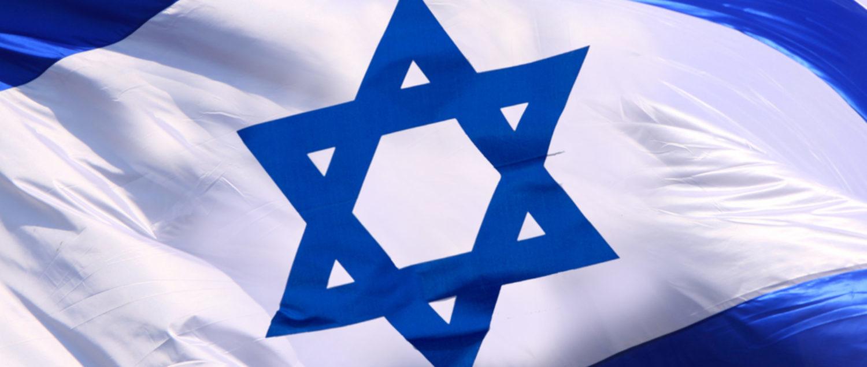 The Israeli flag waves in the wind. (Shutterstock/omnimoney)