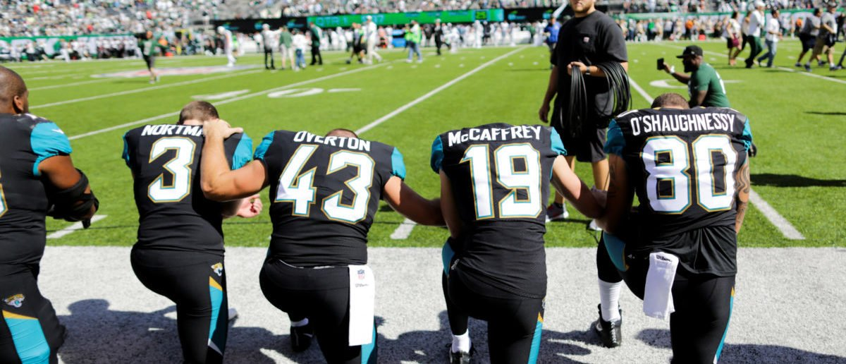 Jacksonville Jaguars players kneel before the national anthem before their NFL football game against the New York Jets in East Rutherford, New Jersey, U.S. October 1, 2017. REUTERS/Eduardo Munoz - RC14C2236150