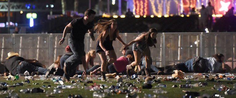 Concert goers run after a gunman opens fire at Route 91 Harvest concert, Oct. 1, 2017. (David Becker/Getty Images)