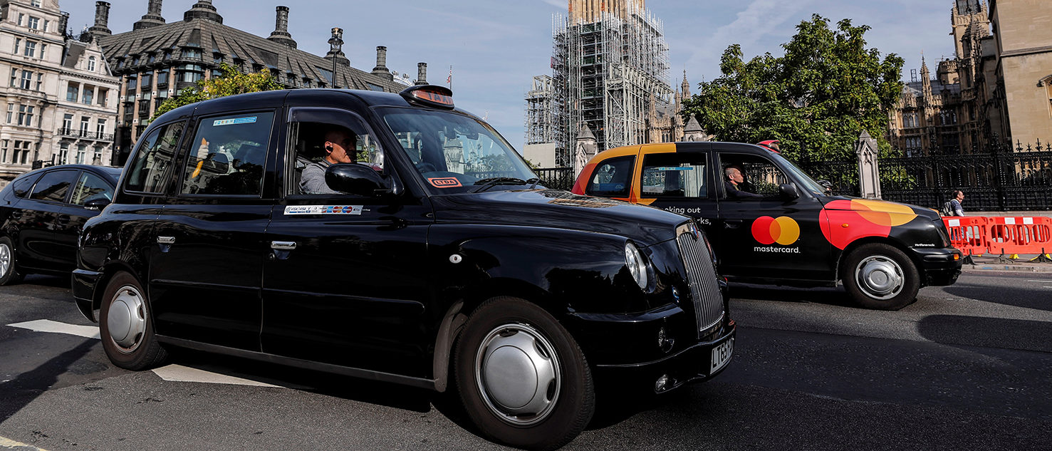Black taxis pass the Houses of Parliament in London, Britain September 24, 2017. REUTERS/Eddie Keogh