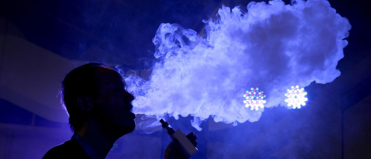 An exhibitor staff member uses an electronic cigarette at Beijing International Vapor Distribution Alliance Expo (VAPE CHINA EXPO) in Beijing, July 24, 2015. According to the organizer, the Expo, which is held in Beijing from July 23 to 25, attracts over 120 companies, including global high-end e-cigarette and e-liquid brands. China's capital city unrolled ambitious new curbs on smoking in early June. Under the new rules, anyone in Beijing who violates the ban, which includes smoking in restaurants, hotels, schools and hospitals as well as in certain outdoor public places, must pay a 200 yuan ($32.25) fine. (Photo: REUTERS/Jason Lee)