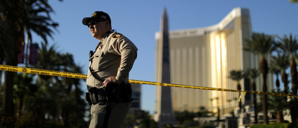 A police officer stands in front of the closed Las Vegas Strip next to the site of the Route 91 music festival mass shooting outside the Mandalay Bay Resort and Casino in Las Vegas, October 3, 2017. REUTERS/Lucy Nicholson
