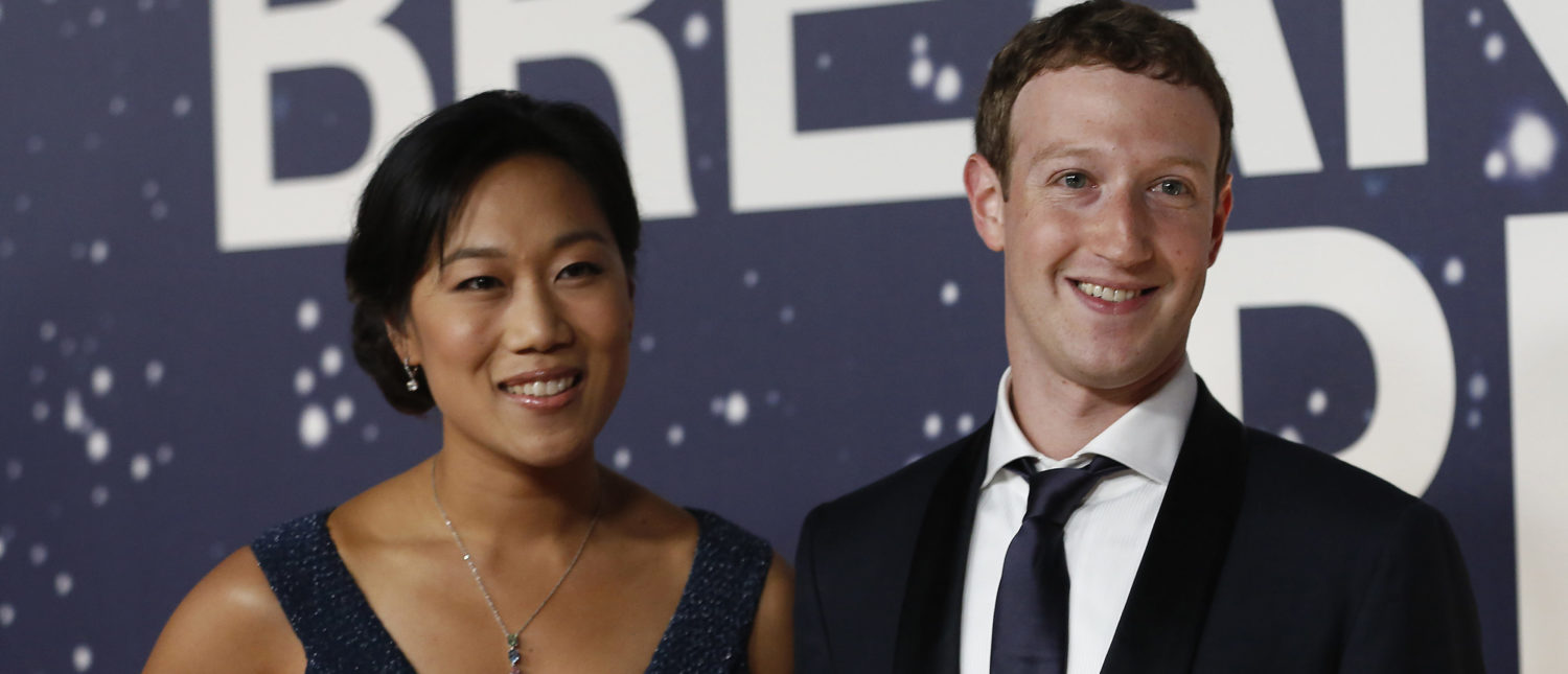 Mark Zuckerberg (R), founder and CEO of Facebook, and wife Priscilla Chan arrive on the red carpet during the 2nd annual Breakthrough Prize Award in Mountain View, California November 9, 2014. (Photo: REUTERS/Stephen Lam)