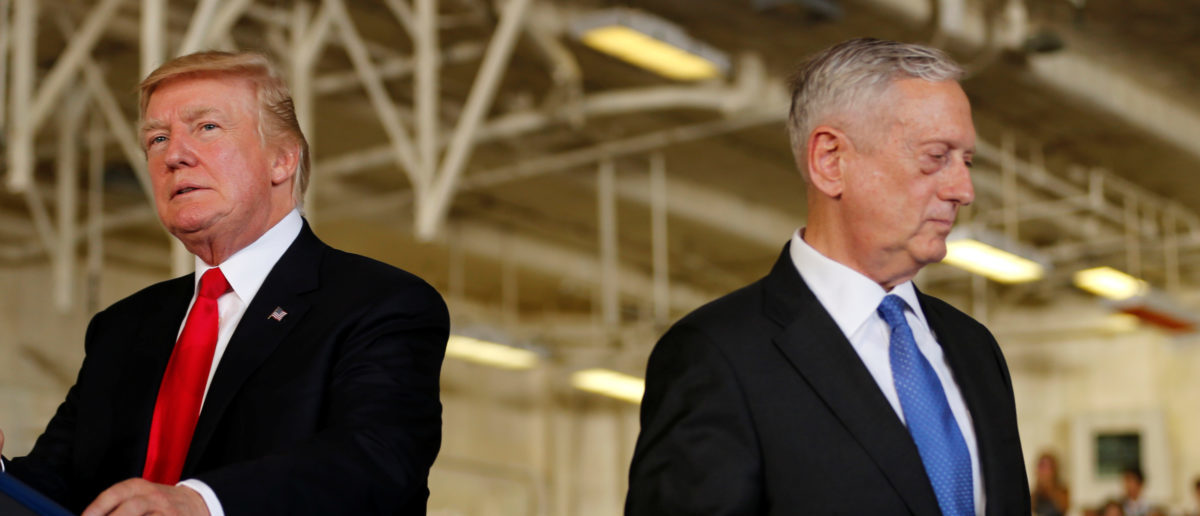 U.S. President Donald Trump (L) is introduced by Defense Secretary James Mattis (R) during the commissioning ceremony of the aircraft carrier USS Gerald R. Ford at Naval Station Norfolk in Norfolk, Virginia, U.S. July 22, 2017. REUTERS/Jonathan Ernst