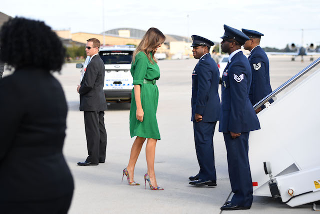 TOPSHOT - US First Lady Melania Trump (C) prepares to board a plane at Joint Base Andrews near Washington on October 10, 2017. Melania Trump will fly to West Virginia to visit Lily's Place, the nation's first nonprofit infant recovery center that also provides services to parents and families dealing with addiction and notably opioid addiction. / AFP PHOTO / JIM WATSON (Photo credit should read JIM WATSON/AFP/Getty Images)