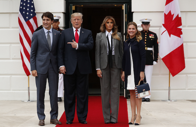 U.S. President Donald Trump and first lady Melania Trump welcome Canadian Prime Minister Justin Trudeau and Mrs. GrÈgoire Trudeau (R) at the White House in Washington, U.S., October 11 2017. REUTERS/Jonathan Ernst - HP1EDAB1DSV6V