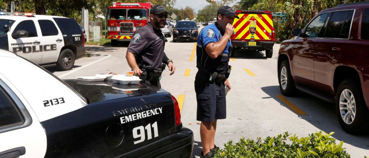 City of Hollywood police officers were on hand for crowds of people and heavy traffic at the Rehabilitation Center at Hollywood Hills in Hollywood, north of Miami, Florida, U.S., September 13, 2017. REUTERS/Andrew Innerarity