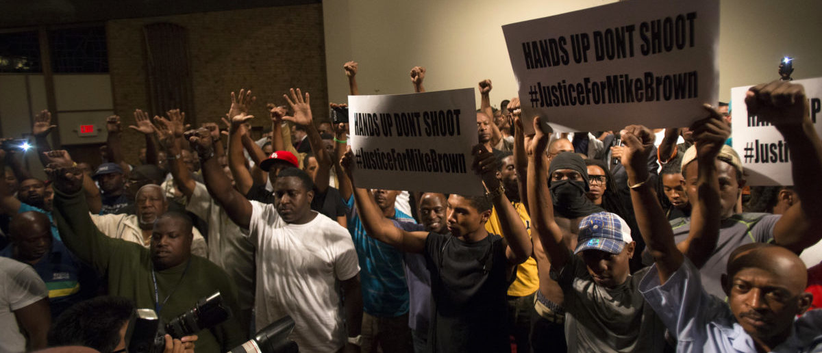 People raise their hands during a gathering to calm tension following the shooting death of black teenager Michael Brown at Greater St. Mark Family Church in St. Louis, Missouri August 12, 2014. Police said Brown, 18, was shot in a struggle with a gun in a police car but have not said why Brown was in the car. At least one shot was fired during the struggle and then the officer fired more shots before leaving the car, police said. But a witness to the shooting interviewed on local media has said that Brown had been putting his hands up to surrender when he was killed. The FBI has opened a civil rights investigation into the racially charged case and St. Louis County also is investigating. REUTERS/Mario Anzuoni