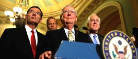 Senate Majority Leader Mitch McConnell, accompanied by Senator John Cornyn (R-TX) and Senator John Barrasso (R-WY). (Photo: Reuters/Aaron P. Bernstein)