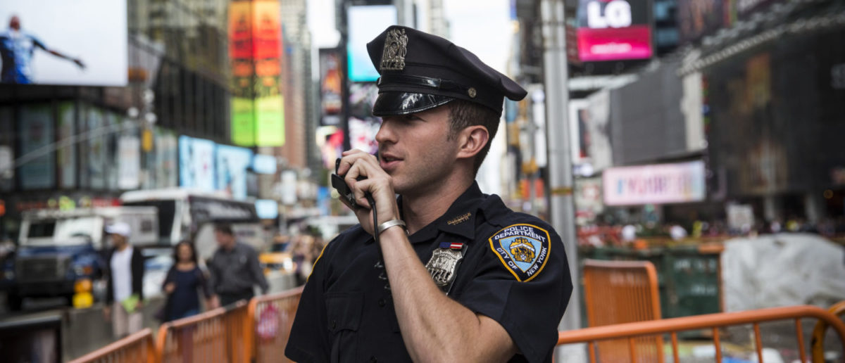 NEW YORK, NY - SEPTEMBER 22: A New York Police Department (NYPD) officer speaks on his radio in Times Square on September 22, 2013 in New York City. (Photo by Andrew Burton/Getty Images)