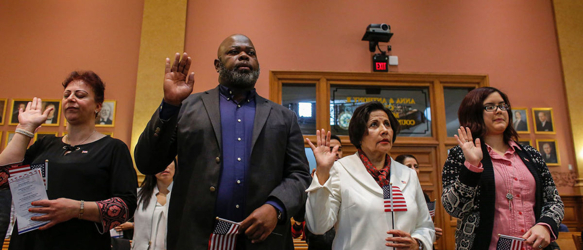 Candidates for US citizenship take the oath of allegiance during a Naturalization Ceremony for new US citizens at the City Hall of Jersey City in New Jersey on February 22, 2017. (Getty Images/AFP/KENA BETANCUR )