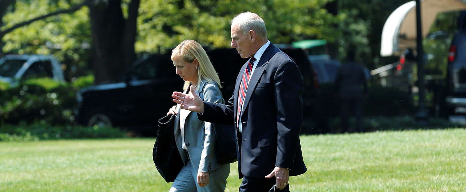 White House Chief of Staff John Kelly (R)  walks with Kirstjen Nielsen, the chief of staff at the Department of Homeland Security, on the South Lawn of the White House in Washington, U.S., before his departure with President Donald Trump to Yuma, Arizona, August 22, 2017. REUTERS/Yuri Gripas