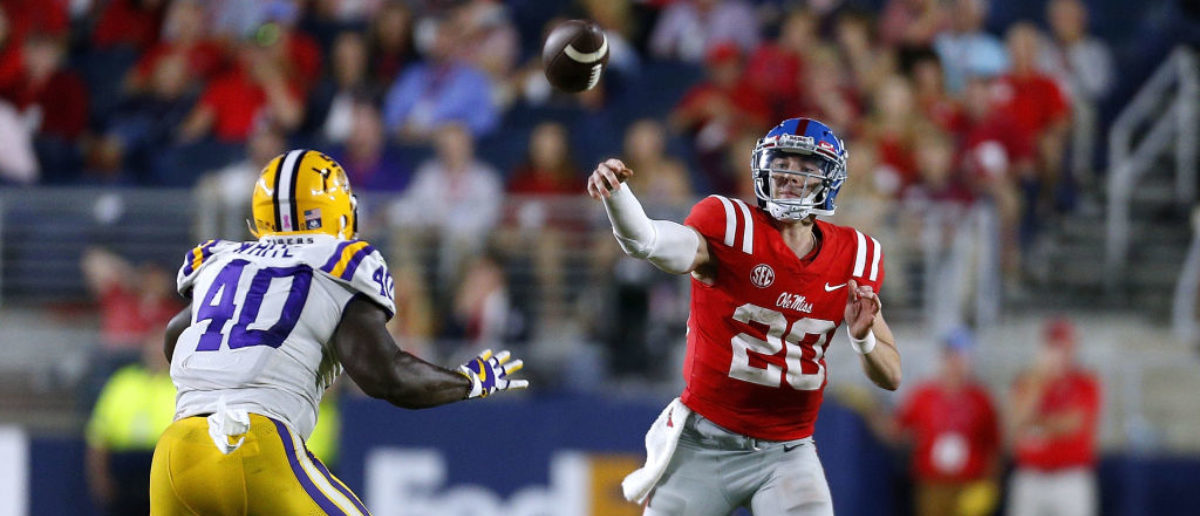OXFORD, MS - OCTOBER 21: Shea Patterson #20 of the Mississippi Rebels throws the ball as Devin White #40 of the LSU Tigers defends during the second half of a game at Vaught-Hemingway Stadium on October 21, 2017 in Oxford, Mississippi. (Photo by Jonathan Bachman/Getty Images)