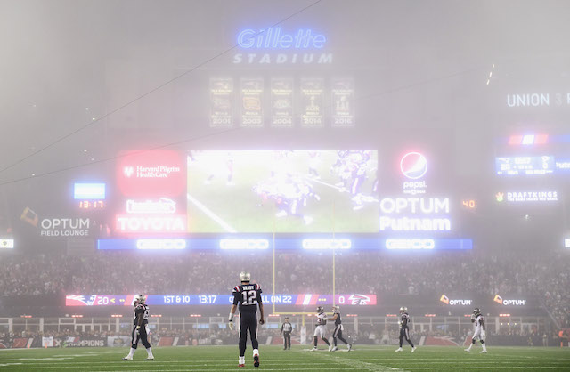 FOXBORO, MA - OCTOBER 22: Tom Brady #12 of the New England Patriots looks on as fog falls on the field during the fourth quarter of a game against the Atlanta Falcons at Gillette Stadium on October 22, 2017 in Foxboro, Massachusetts. (Photo by Billie Weiss/Getty Images)