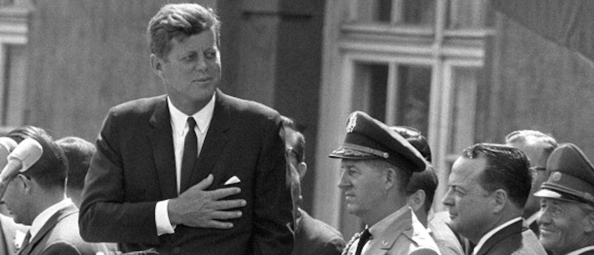 "Picture taken on June 26, 1963 shows then US President John F Kennedy (L) giving a speech at the Schoeneberg city hall in Berlin, where he said his famous German sentence ""Ich bin ein Berliner"" (I am a Berliner) to underline the support of the United States for West Germany and his empathy for people living in the divided city of Berlin. B/W ONLY AFP PHOTO / GERMANY OUT (Photo credit should read DPA/AFP/Getty Images)"