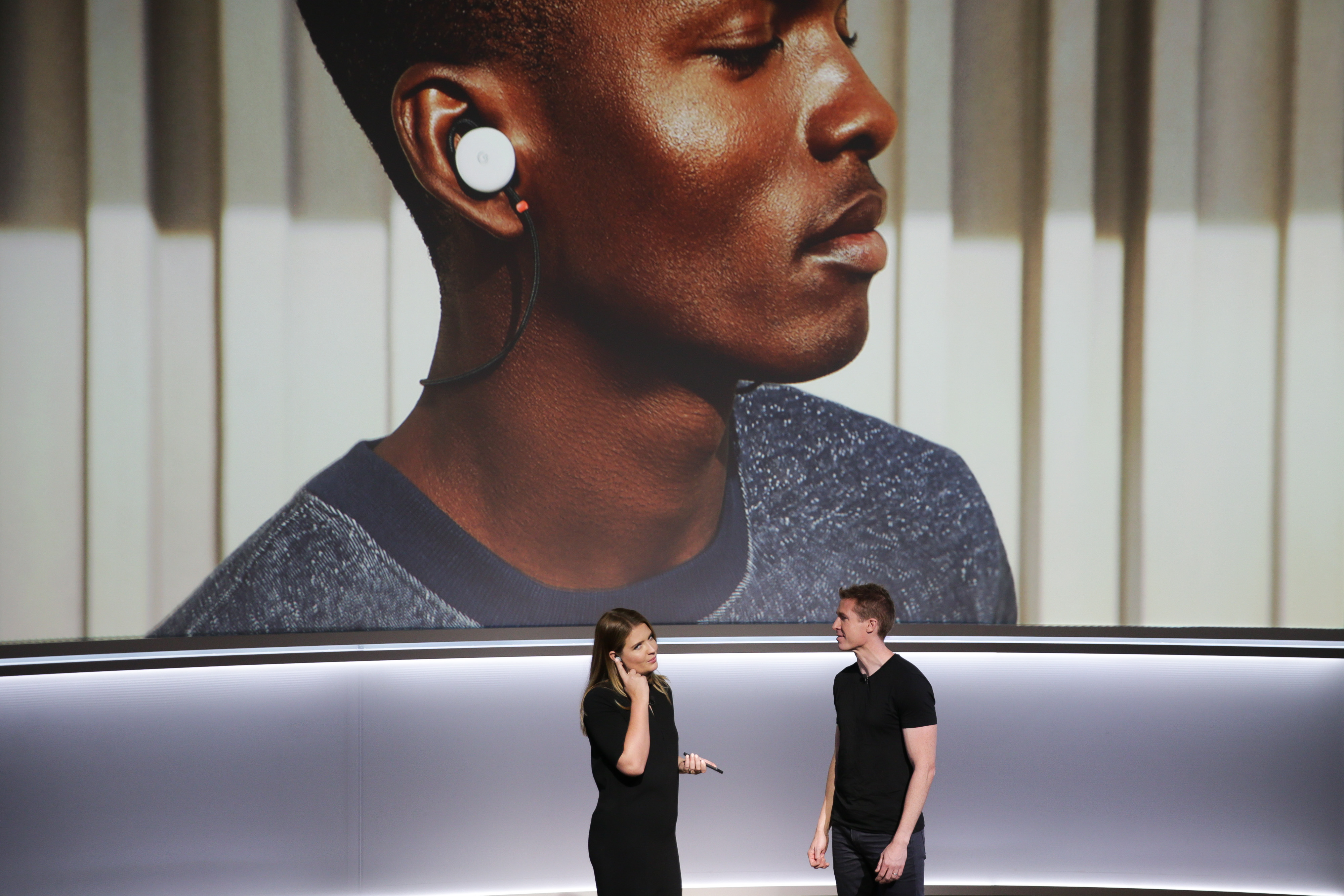 Isabelle Olsson, lead designer for home hardware for Google, and Juston Payne, Product Manager for Google Clips, demonstrate two-way translation using Google Pixel Buds and the Google Pixel 2 smartphone at a product launch event on October 4, 2017 at the SFJAZZ Center in San Francisco, California. (Photo: ELIJAH NOUVELAGE/AFP/Getty Images)