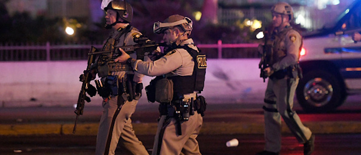 LAS VEGAS, NV - OCTOBER 02: Police officers point their weapons at a car driving down closed Tropicana Ave. near Las Vegas Boulevard after a reported mass shooting at a country music festival nearby on October 2, 2017 in Las Vegas, Nevada. A gunman has opened fire on a music festival in Las Vegas, leaving at least 2 people dead. Police have confirmed that one suspect has been shot. The investigation is ongoing. (Photo by Ethan Miller/Getty Images)