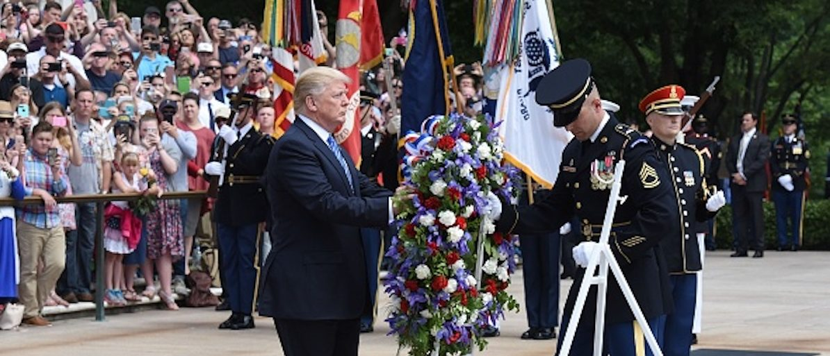 ARLINGTON, VA - MAY 29: President Donald Trump participates in a wreath-laying ceremony at the Tomb of the Unknown Soldier at Arlington National Cemetery on Memorial Day, May 29, 2017 in Arlington, Virginia. (Photo by Olivier Douliery - Pool/Getty Images)
