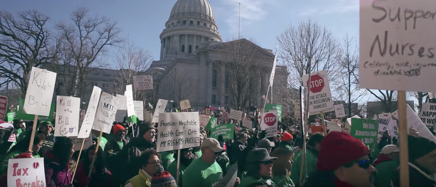 Pro-union protestors march in Wisconsin in 2011. (YouTube screenshot/New Left Media)