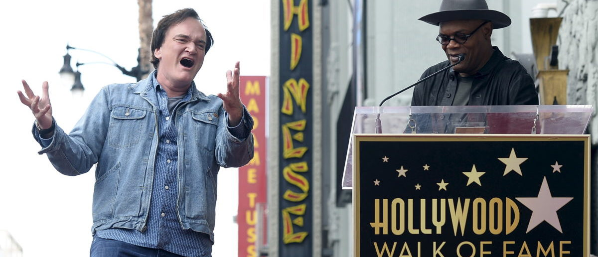 Filmmaker Quentin Tarantino (L) sings happy birthday to actor and event emcee Samuel L. Jackson before the unveiling of his star on the Hollywood Walk of Fame in Hollywood, California, December 21, 2015. REUTERS/Kevork Djansezian