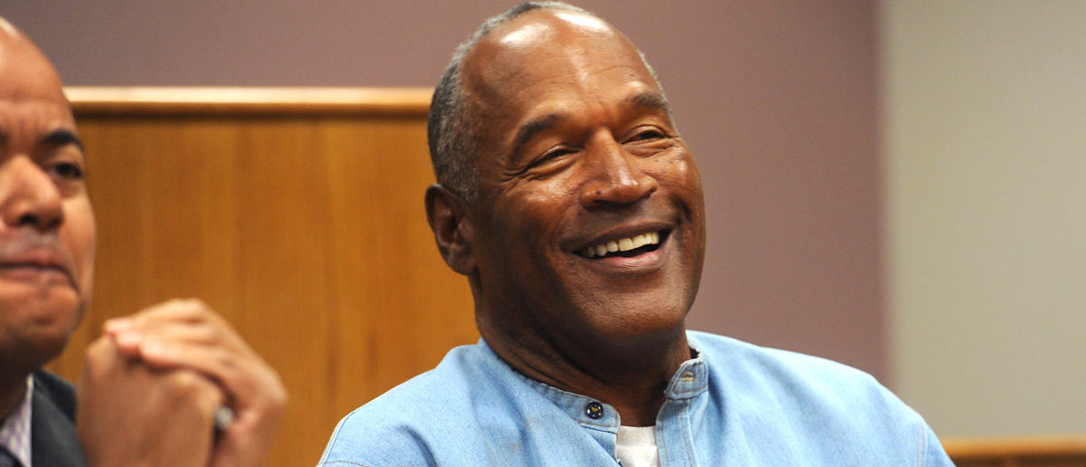 O.J. Simpson reacts during his parole hearing at Lovelock Correctional Center in Lovelock, Nevada, U.S., July 20, 2017. REUTERS/Jason Bean/Pool - RC1EA37EDB80
