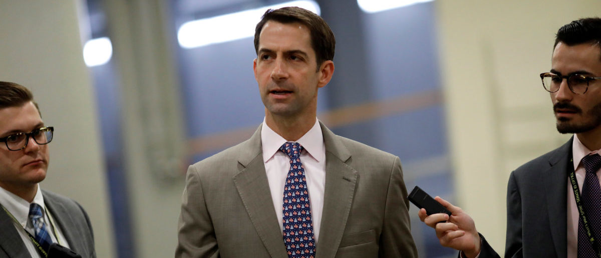 Sen. Tom Cotton (R-AR) speaks with reporters ahead of the party luncheons on Capitol Hill in Washington, U.S., September 19, 2017. REUTERS/Aaron P. Bernstein - RC1C73CFE370