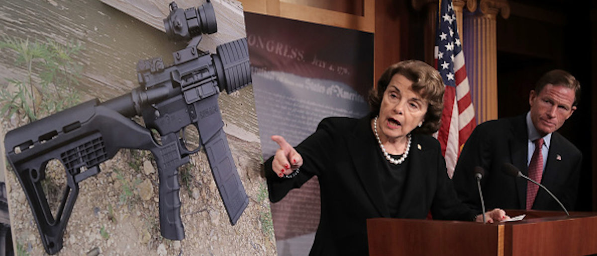 """WASHINGTON, DC - OCTOBER 04: Sen. Dianne Feinstein (D-CA) (C) and Sen. Richard Blumenthal (D-CT) points to a photograph of a rifle with a """"bump stock"""" during a news conference to announce proposed gun control legislation at the U.S. Capitol October 4, 2017 in Washington, DC. In reaction to Sunday's mass shooting in Las Vegas that left 59 people dead and hundreds injured, Feinstein's legislation would ban devices that could make weapons fully automatic. (Photo by Chip Somodevilla/Getty Images)"""