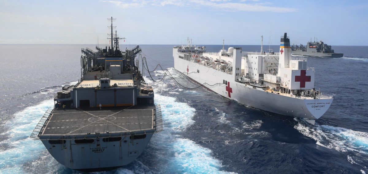 ATLANTIC OCEAN (Oct. 1, 2017) The Military Sealift Command hospital ship USNS Comfort (T-AH 20), center, conducts an underway replenishment with the dry cargo and ammunition ship USNS William McLean (T-AKE 12), left, and the fast combat support ship USNS Supply (T-AOE 6). Comfort is underway to support humanitarian relief operations in Puerto Rico. The Department of Defense is supporting the Federal Emergency Management Agency, the lead federal agency, in helping those affected by Hurricane Maria to minimize suffering and is one component of the overall whole-of-government response effort. (U.S. Navy Photo by Mass Communication Specialist 1st Class Ernest R. Scott/Released)171001-N-ZN152-0045 Join the conversation: http://www.navy.mil/viewGallery.asp http://www.facebook.com/USNavy http://www.twitter.com/USNavy http://navylive.dodlive.mil http://pinterest.com https://plus.google.com