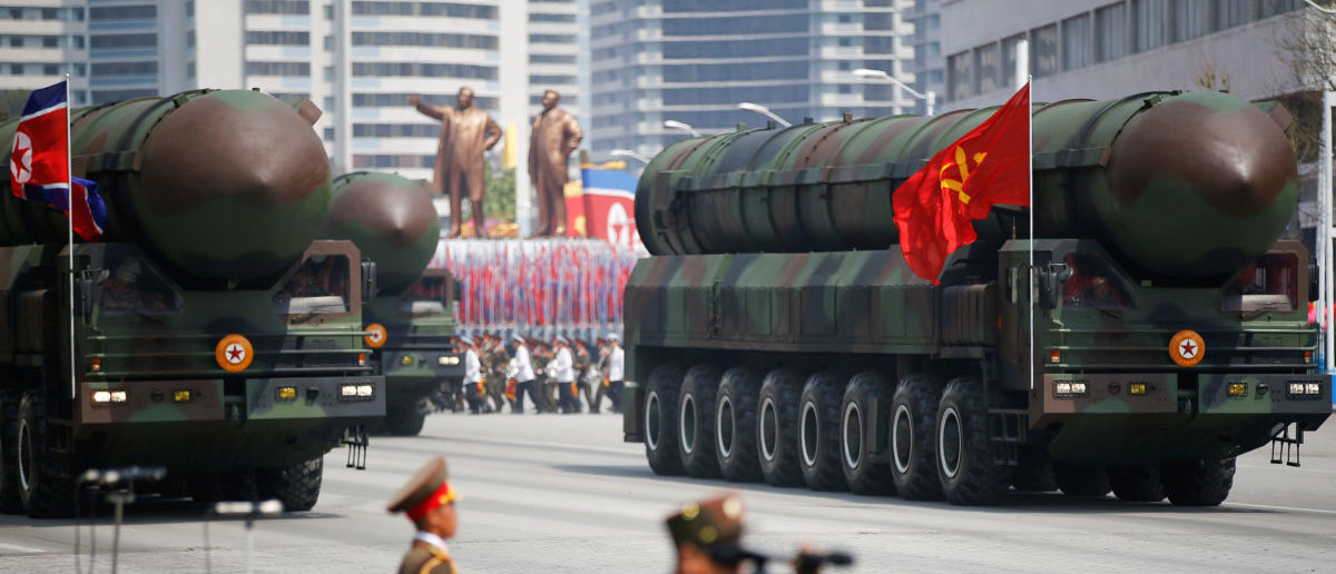 Intercontinental ballistic missiles (ICBM) are driven past the stand with North Korean leader Kim Jong Un and other high ranking officials during a military parade marking the 105th birth anniversary of country's founding father Kim Il Sung, in Pyongyang April 15, 2017. The missiles themselves were shown for the first time inside a new kind of canister-based launcher on Saturday. The trucks upon which they are mounted are originally designed to move lumber. REUTERS/Damir Sagolj