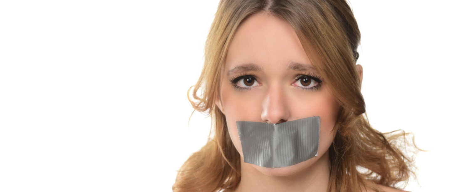 Duct tape prevents a student from speaking. (Shutterstock/junostock)