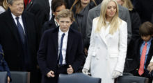 Donald Trump's son Barron (L) and daughter Tiffany await the start of the inauguration ceremonies to swear in their father as the 45th president of the United States on the West front of the U.S. Capitol in Washington, U.S., January 20, 2017.  REUTERS/Lucy Nicholson -